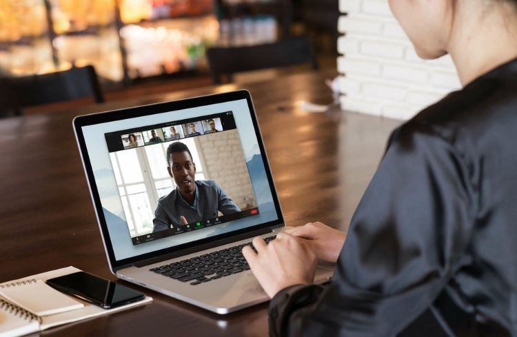 A lady attending a Zoom meeting
